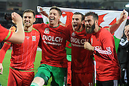 Aaron Ramsey (l), Wayne Hennessey, Gareth Bale and Joe Ledley ® celebrate after the match as the Wales team qualify for Euro 2016 finals in France.  Wales v Andorra, Euro 2016 qualifying match at the Cardiff city stadium  in Cardiff, South Wales  on Tuesday 13th October 2015. <br /> pic by  Andrew Orchard, Andrew Orchard sports photography.