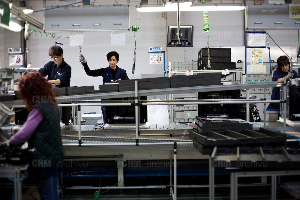 Women working in the factory of Whirlpool Corporations. Cassinetta di Biandronno, Varese, Milan, Italy, 30 january 2014. Guido Montani / OneShot