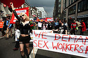 Campaigner for sex workers rights. Demonstration by unions and other organisations of workers to mark the annual May Day or Labour Day. Groups from all nationalities from around the World, living in London gathered to march to a rally in central London, UK.