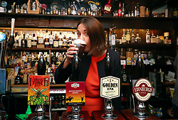 """Scottish Labour leader Kezia Dugdale behind the bar of the Kilderkin pub in Edinburgh's Canongate to show support for legislation to help pub landlords who have a """"tied"""" arrangement with large companies that own them, often known as """"pubcos""""."""