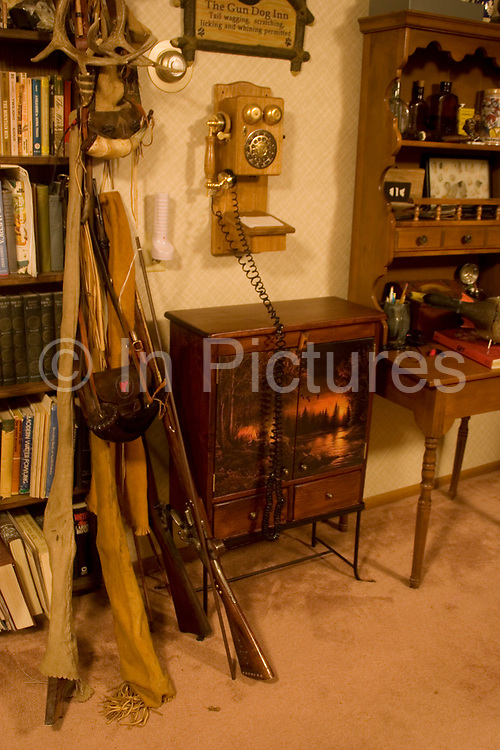 Hunter Byron Grubb's home in Burlington near Minot, North Dakota is full of the guns, trophies, stuffed animals and hunting paraphernalia of an experienced hunter. Here, basement room is full of muskets, fishing rods, old shotgun shells and hand made leather goods.