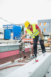 Construction worker at building site, Munich, Bavaria, Germany