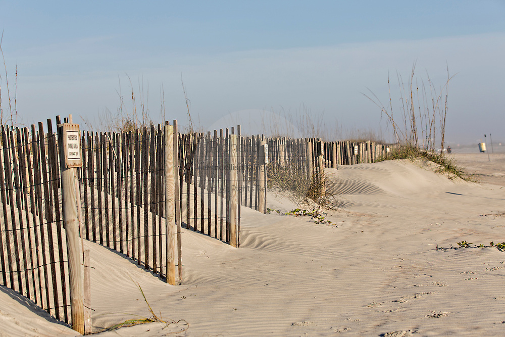 Sand fence to rebuild the dunes on St Augustine Beach, Florida.
