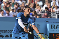 June 19, 2018 - London, England, United Kingdom - Australia's Nick Kyrgios serves to Britain's Andy Murray during their first round men's singles match at the ATP Queen's Club Championships tennis tournament in west London on June 19, 2018. Britain's Andy Murray was beaten 2-6, 7-6 (7/4), 7-5 by Australian Nick Kyrgios in the Queen's Club first round. (Credit Image: © Alberto Pezzali/NurPhoto via ZUMA Press)
