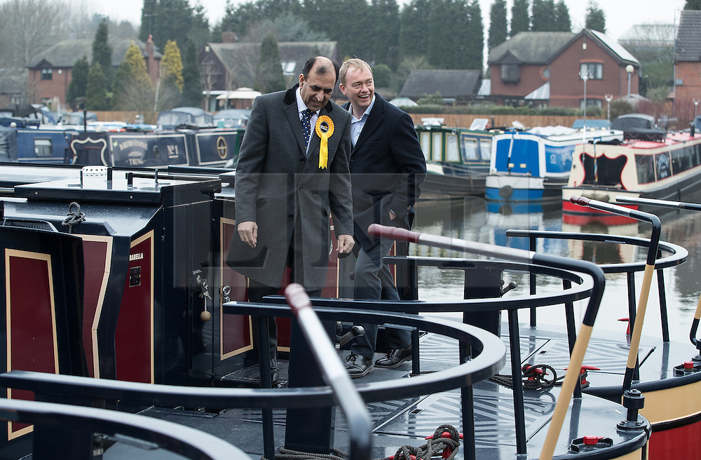 © Licensed to London News Pictures . 14/02/2017 . Stoke-on-Trent , UK . Lib Dem leader TIM FARRON (r) joins candidate DR ZULFIQAR ALI , campaigning at Festival Park Marina in Etruria , in the Stoke Central by-election . Photo credit : Joel Goodman/LNP