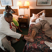 GREENVILLE, MS - September 3, 2005:  Dr. Ronald Myers, dealing with the Hurricane Katrina crisis professionally and personally, checks his injured father-in-law, Leamalie Holmes, 83, while making rounds of Katrina evacuees in Greenville, Mississippi on September 3, 2005. As a doctor and advocate for the poor, he is treating evacuees from New Orleans and other parts of Louisiana and Mississippi in shelters and at homes where the evacuees have taken up residence. His personal home and his in-laws home were severely damaged and all are living in a Ramada Inn...