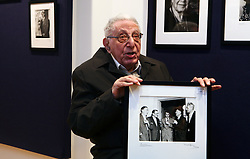 © Licensed to London News Pictures 08/04/2013.Photographer Mark Gerson, 91, poses with one of his photos depicting from left, Louis McNeice, TS Eliot, Ted Hughes, WH Auden and Stephen Spender at Bonhams Auction House in London. A selection of his prints will be sold as part of the 'Roy Davids Collection Part III: Poetry: Poetical Manuscripts and Portraits of Poets', on 10th April and 8th May, at Bonhams, London. .London, UK.Photo credit: Anna Branthwaite