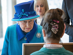 © Licensed to London News Pictures . 14/11/2013 . Manchester , UK . The Queen meets children from a local school . Queen Elizabeth II and the Duke of Edinburgh visit the Coop building at 1 Angel Square , Manchester , this morning ( 14th November 2013 ) . Photo credit : Joel Goodman/LNP