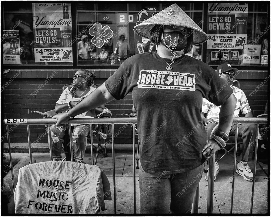 NEWARK, NEW JERSEY: House music lovers sit outside side on the barricades lined on Edison place during the weekly Block Party in Newark, NJ on Friday, July 30, 2021 (Brian B Price/TheFotodesk).