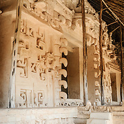 """Carved decorations on the exterior of the Tomb of Ukit Kan Le'k Tok' on top of the Acropolis on the northern side of the Ek'Balam archeological site on Mexico's Yucatan Peninsula. It was once a thriving city of Maya Civilization dating to the Late Classic period. It is 30km north of Valladolid and is named for """"Black Jaguar"""" a distinctive motif throughout the site."""