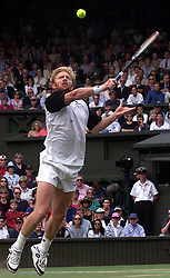 No commercial use. Boris Becker in action during his match against Patrick Rafter, during the 1999 Wimbledon tennis Championships. Rafter defeated Becker 6-3 6-2 6-3.