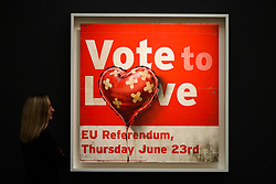 © Licensed to London News Pictures. 07/02/2020. London, UK. A staff member views Banksy's painting titled 'Vote to Love' (Est £400,000 - £700,000) at the preview of Sotheby's Contemporary Art. The auction will take place at Sotheby's in central London on 11 and 12 February 2020. Photo credit: Dinendra Haria/LNP