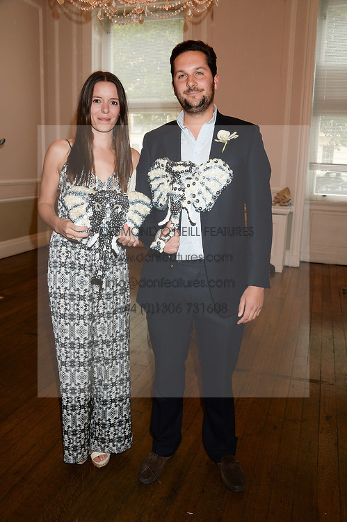 ROSE SIMMONDS and OLIVER TOMALIN at the The Animal Ball – Masking Up Moment held at the Quintessentially Ballrooms, 29 Portland Place, London W1 on 10th June 2013.
