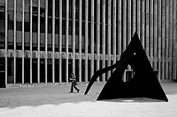An unsuspecting man unaware of what's following behind him (Le Guichet (1963) by Alexander Calder. ) at Lincoln Center.