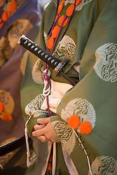 Asia, Japan, Honshu island, Kanagawa Prefecture, Kamakura, silk kimono worn by assistants during Yabusame, a revival of medieval samurai archery on horseback, at Kamakura Matsuri, an annual festival held at the Tsurugaoka Hachimangu shrine