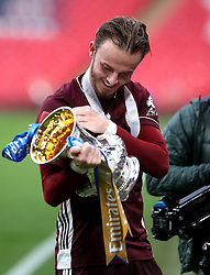 Leicester City's James Maddison celebrates with the trophy after the Emirates FA Cup Final at Wembley Stadium, London. Picture date: Saturday May 15, 2021.