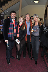 Left to right, MARK STEWART, his daughter LEONA STEWART, NICK MASON and NETTE MASON attend the premier of 2012 Cirque du Soleil's Totem at the Royal Albert Hall, London on 5th January 2012,