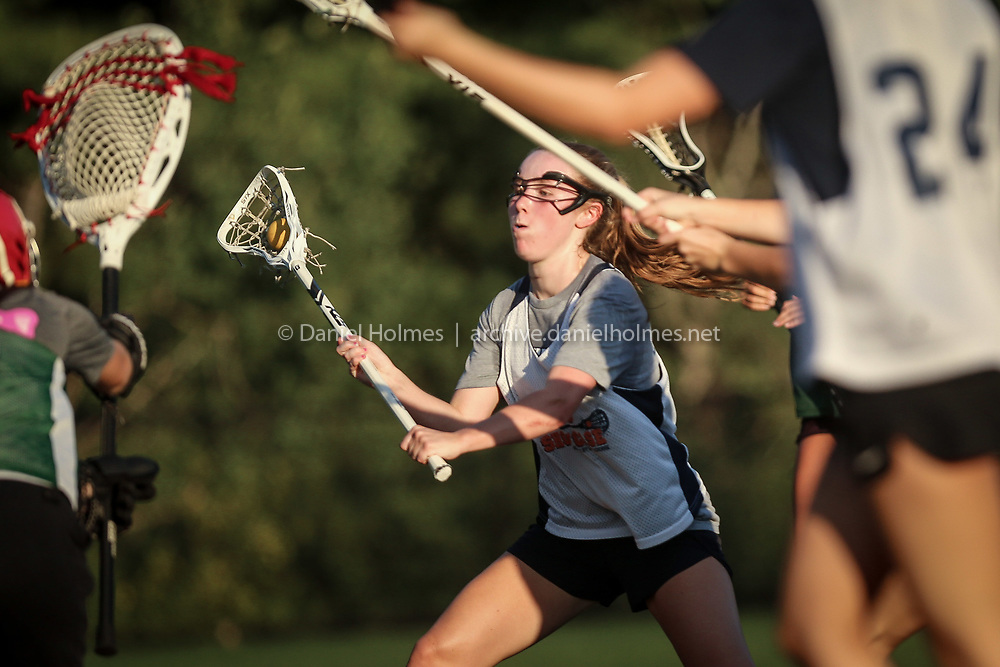 Franklin's Jackie O'Neil shoots and scores during the Gold Star Lacrosse league match against Bishop Feehan at Medway High School, on Jul. 27, 2020. [Daily News and Wicked Local Photo/Dan Holmes]