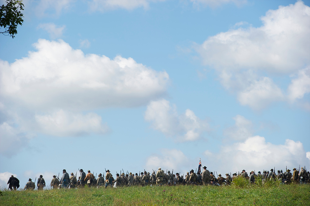 Confederate soldiers advance over a ridge during the Battle of Perryville 150th Anniversary in Perryville, Kentucky on October 7, 2013.