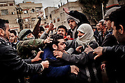 Demonstrators beat a man accused of being an infiltrated security officers caught during a funeral of a fighter from the Free Syrian Army shot in combat with security forces, in Sakba, in the outskirts of Damascus, January 27, 2012, Photo/Tomas Munita