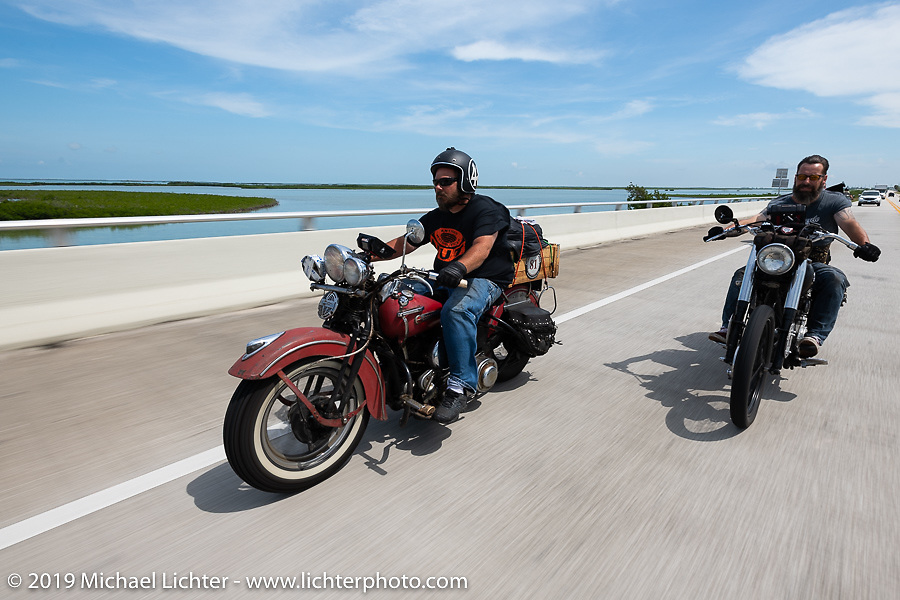 Richard Kaylor (L) and Shane Masters riding through the Keys on the last day of the Cross Country Chase motorcycle endurance run from Sault Sainte Marie, MI to Key West, FL. (for vintage bikes from 1930-1948). Stage-10 covered 110 miles from Miami to the finish in Key West, FL USA. Sunday, September 15, 2019. Photography ©2019 Michael Lichter.