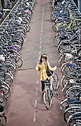 Parking the bike outside Amsterdam Centraal Station.