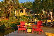 Muskoka chairs and cottage at Star Lake<br />Whiteshell Provincial Park<br />Manitoba<br />Canada