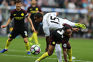 Raheem Sterling of Manchester city is challenged by Wayne Routledge of Swansea city.  Premier league match, Swansea city v Manchester city at the Liberty Stadium in Swansea, South Wales on Saturday 24th September 2016.<br /> pic by Andrew Orchard, Andrew Orchard sports photography.