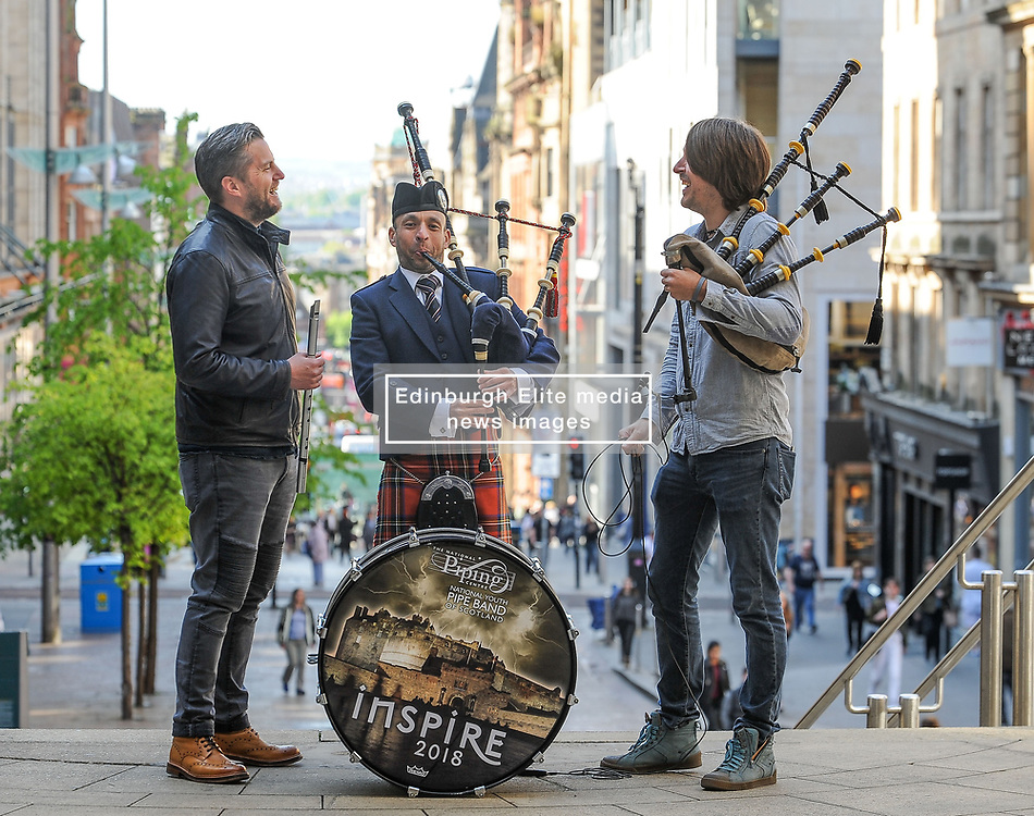 Pictured: Alasdair MacLaren (centre) from Glasgow Police Pipe Band join festival headliners Finlay MacDonald and Ross Ainslie at the launch.<br /> <br /> Glasgow Police Pipe Band were on hand to make sure the launch for this years Piping Live! Glasgow Piping Festival was no quiet affair outside Glasgow Royal Concert Hall.<br /> <br /> © Dave Johnston / EEm