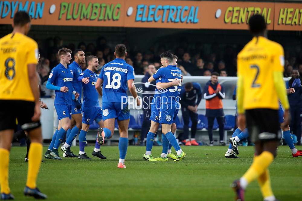 AFC Wimbledon midfielder Callum Reilly (33) celebrating after scoring goal to make it 1-0 during the EFL Sky Bet League 1 match between AFC Wimbledon and Southend United at the Cherry Red Records Stadium, Kingston, England on 1 January 2020.