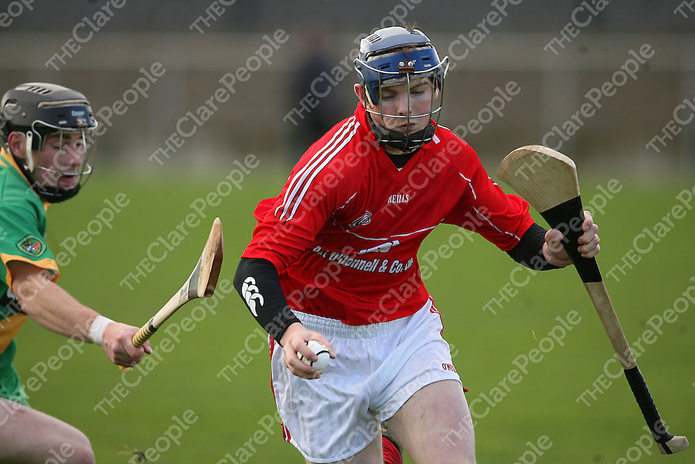 Crusheen's Alan Tuohy gets around O' Callaghans Mills Johathan Lyons during the Senior B hurling final in Clarecastle on Sunday afternoon.<br /> Photograph by Yvonne Vaughan