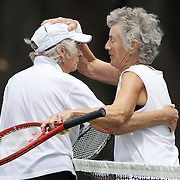 Elaine Stephan, New Zealand, is congratulated by Joyce Cutts, Canada in the Bronze Medal play off match in the Queens Cup Competition during the 2009 ITF Super-Seniors World Team and Individual Championships at Perth, Western Australia, between 2-15th November, 2009.