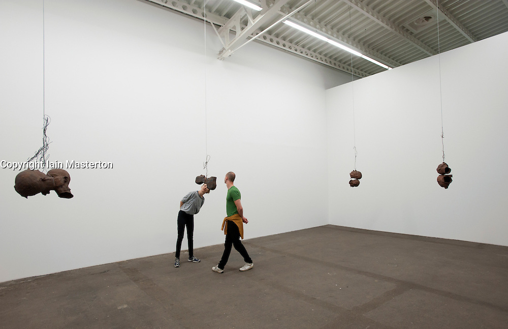 Sculpture by Bruce Nauman titled Four Pairs of Heads at Hamburger Bahnhof Museum of Contemporary Art in Berlin Germany
