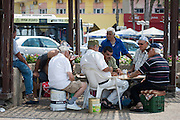 Israel, Tel Aviv, A group of old men playing Dominoes at an outdoor table