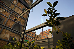 Centrale, a restaurant designed by architect Bernard Khoury, is seen in Beirut, Lebanon, March 20, 2006. The building was preserved in it's post-war state, but reinforced with metal. The building under construction in the background is an apartment bloc he designed as well.