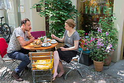 People having brunch at weekend at Anna Blume cafe in Prenzlauer Berg in Berlin Germany