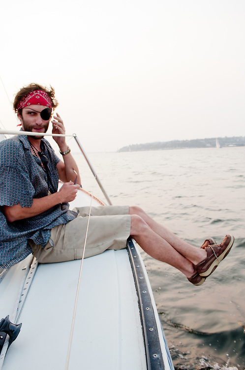 My friend Nick dressed as a Pirate on hist sailboat on Elliot Bay, Seattle, Washington.