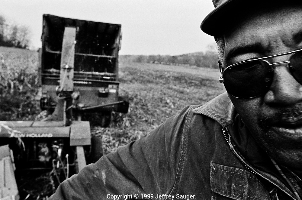 BIDWELL, OHIO - November 1999: Bill Howard cuts corn into silage that will be used to feed the 100 head of cows he owns in Bidwell, Ohio, in November 1999. In 1969 Howard bought his farm and today he is the last African American dairy farmer in Gallia County, Ohio. With his son Andy and daughter Diane not in the farming business, this may be the last generation of the Howard family to farm. In 1997, the United States Census reported that there were only five dairy or cattle farms in Ohio operated by black and other non-caucasian races. (Photo by Jeffrey Sauger)