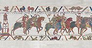 Bayeux Tapestry scene 16: Harold rides with Duke William to fight Conan, Duke of Britany.  BYX16 .<br /> <br /> If you prefer you can also buy from our ALAMY PHOTO LIBRARY  Collection visit : https://www.alamy.com/portfolio/paul-williams-funkystock/bayeux-tapestry-medieval-art.html  if you know the scene number you want enter BXY followed bt the scene no into the SEARCH WITHIN GALLERY box  i.e BYX 22 for scene 22)<br /> <br />  Visit our MEDIEVAL ART PHOTO COLLECTIONS for more   photos  to download or buy as prints https://funkystock.photoshelter.com/gallery-collection/Medieval-Middle-Ages-Art-Artefacts-Antiquities-Pictures-Images-of/C0000YpKXiAHnG2k