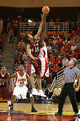 01 January 2006..Dinma Odiakosa blocks out Bryan Mullins during the opening tip off between Randal Falker and Greg Dilligard...The Southern Illinois Saluki's chewed up the Illinois State Redbirds with 37 points in the 2nd half to beat the birds with a final score of 65-52.  An audience of just over 7500 watched the in Redbird Arena on the campus of Illinois State University in Normal Illinois.....