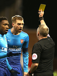 07 January 2018 FA Cup 3rd round Nottingham - Nottingham Forest v Arsenal - Per Mertesacker of Arsenal receives a yellow card from referee Jonathan Moss.<br /> (photo by Mark Leech)