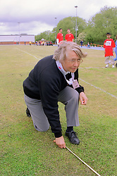 Judge measuring distance at Mini games sports event held at Stoke Mandeville Stadium,