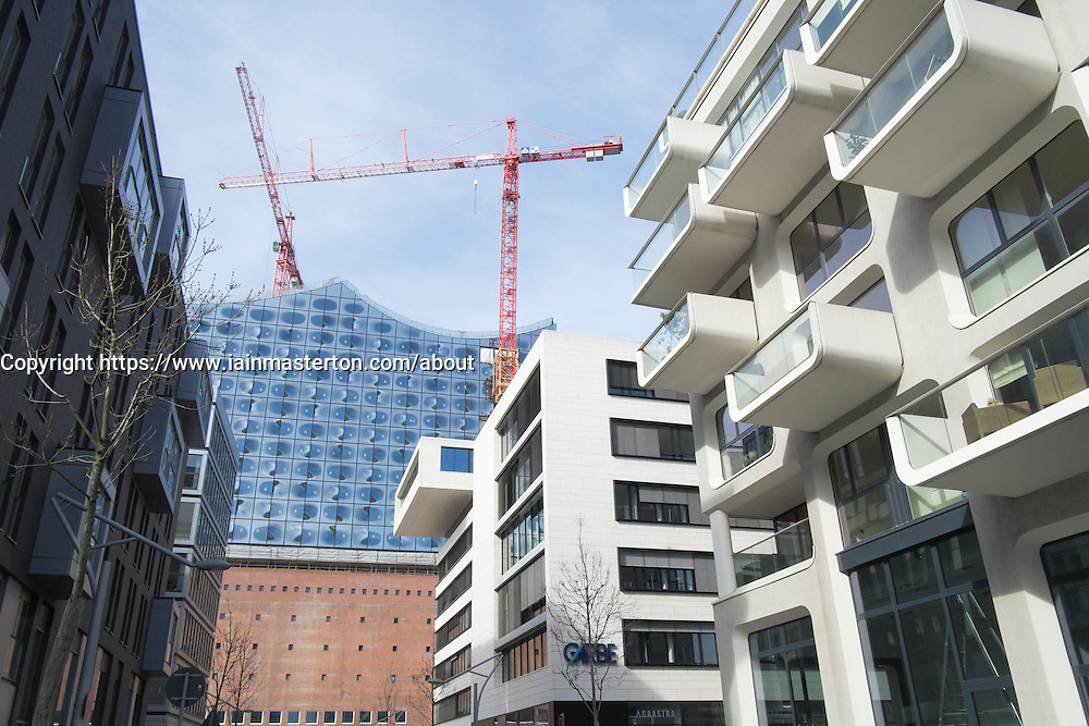 Modern apartment building and new opera house under construction at Hafencity modern property development in Hamburg Germany