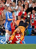 Photo: Richard Lane.<br />Chelsea v Liverpool. UEFA Champions League. Semi Final, 1st Leg. 25/04/2007. <br />Liverpool's Pepe Reina flighs over Jamie Carragher.
