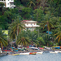 Americas, Caribbean, Antigua & barbuda. Shoreline of Antigua island - small fishing town with boats docked.