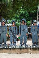 El Nido, Palawan, Philippines - July 14, 2019: Visitors to Seven Commandos Beach near El Nido pose for a picture.