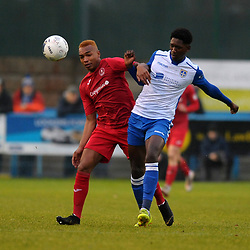 TELFORD COPYRIGHT MIKE SHERIDAN Marcus Dinanga battles with Dylan Barkers during the Buildbase FA Trophy 3Q fixture between Guiseley and AFC Telford United at Nethermoor Park on Saturday, November 23, 2019.<br /> <br /> Picture credit: Mike Sheridan/Ultrapress<br /> <br /> MS201920-031