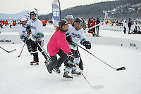 Joe's Chicks and the Shore Shots  hit the ice for first round Women's Division action at the New England Pond Hockey Classic at Meredith Bay Friday morning.  (Karen Bobotas/for the Laconia Daily Sun)