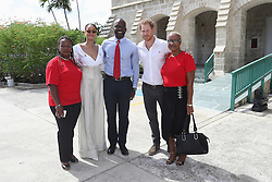 Councillor Ministry of Health HIV Program Susette Neblett-Straughn (left), Rihanna (second left) and Prince Harry (second right) pose for a photo during the 'Man Aware' event held by the Barbados National HIV/AIDS Commission in Bridgetown, Barbados, during his tour of the Caribbean.