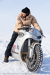 "Russian rapper Levan formally known as ""L1"" with 2-million Instagram followers) on Yaroslav Tatarinov's custom Kawasaki 1350 GTR at the Baikal Mile Ice Speed Festival. Maksimiha, Siberia, Russia. Saturday, February 29, 2020. Photography ©2020 Michael Lichter."